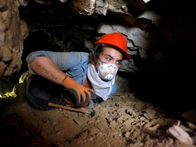 Kathryn Webb is seen inside one of two man-made tunnels excavated by Hebrew University archaeologist Oren Gutfeld near the Qumran area, Israeli-occupied West Bank, October 14, 2018.