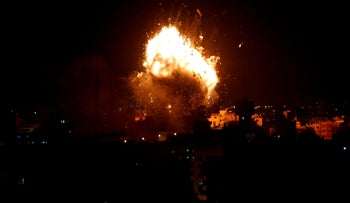 File Photo: An explosion is seen during an Israeli air strike on Hamas's television station, in Gaza City, November 12, 2018.