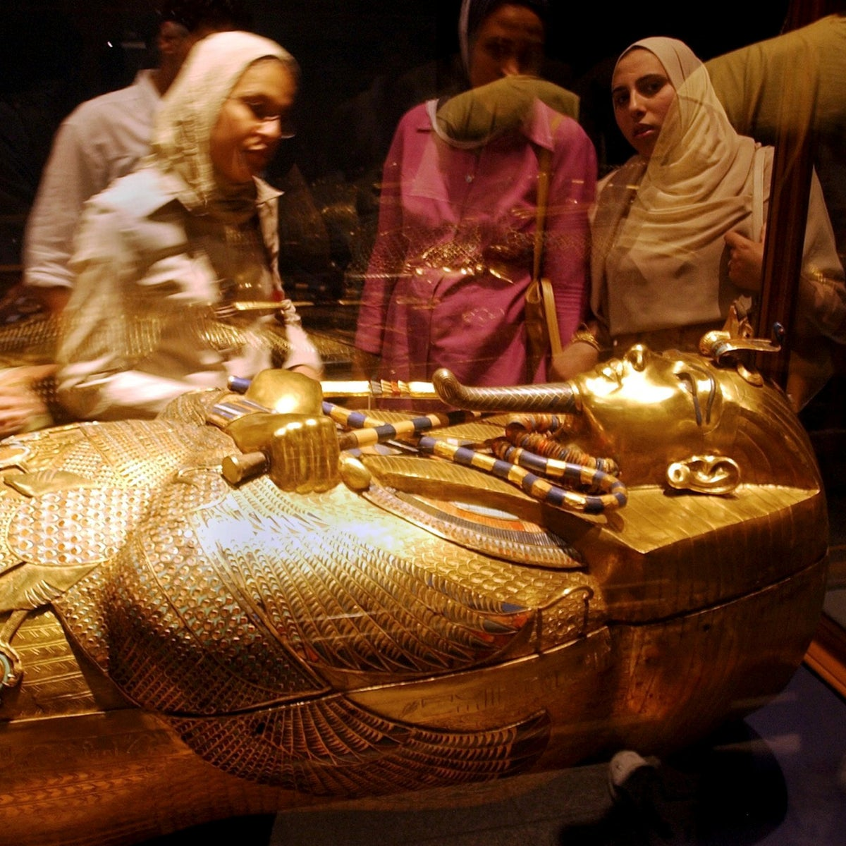 File photo: People admire the third and innermost of the three anthropoid coffins of Tutankhamun at the Egyptian Museum in Cairo, April 5, 2003.