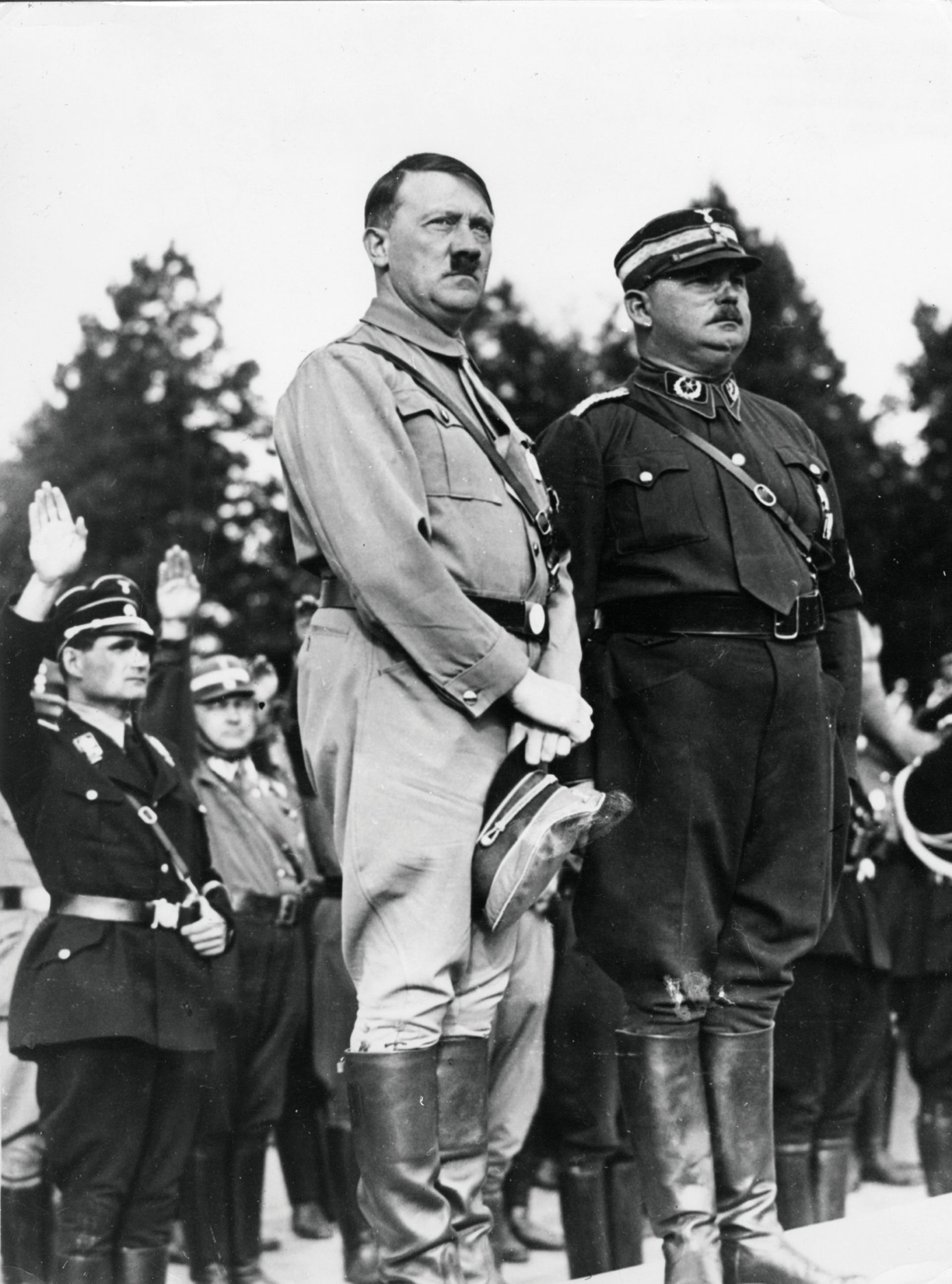 Hitler and Roehm, in the year before the fuehrer purged the SA head and his followers.
