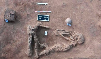 A skeleton at the Kom al-Kholgan archaeological site, about 140 kilometers (87 miles) north of Cairo, Egypt, on Wednesday, January 23, 2019.