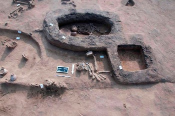 A burial site dating back to the Predynastic Period in Kom al-Kholgan archaeological site, about 140 kilometers (87 miles) north of Cairo, Egypt, on Wednesday, January 23, 2019.