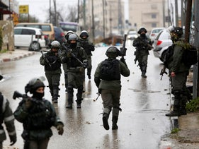File photo: Israeli forces deploy during a raid in the West Bank City of Ramallah, January 9, 2019.