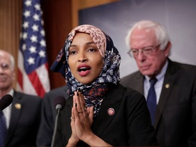 Freshman Rep. Ilhan Omar, D-Minn., center, joins Rep. Peter Welch, D-Vt., left, and Sen. Bernie Sanders, at a news conference on Capitol Hill in Washington, Thursday, January 10, 2019.
