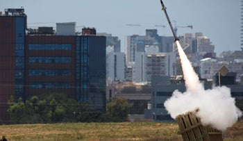 ARCHIVE - An Iron Dome launcher fires an interceptor rocket in the southern Israeli city of Ashdod July 11, 2014.