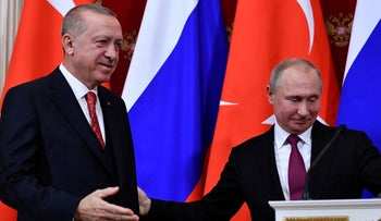 Russian President Vladimir Putin, right, and Turkey's President Recep Tayyip Erdogan leave their joint news conference following talks in the Kremlin in Moscow, Russia, Wednesday, Jan. 23, 2019