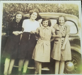 Alisa Tennenbaum, right, pictured with three girls she lived with at a hostel in England during World War II.