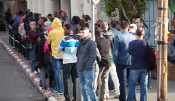 The line stretching from the entrance to the Population and Immigration Authority office in Tel Aviv, 2017