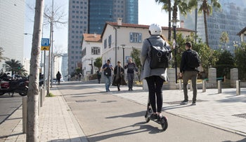 File photo: Woman rides electric scooter in central Tel Aviv, January 22, 2019.