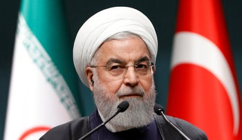 Iranian President Hassan Rohani at a news conference in Ankara, December 20, 2018.
