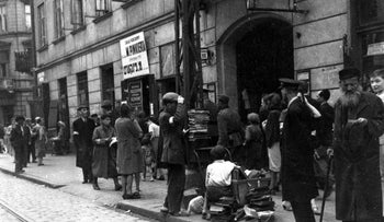 FILE Photo: People line up long the streets of the Warsaw Ghetto.