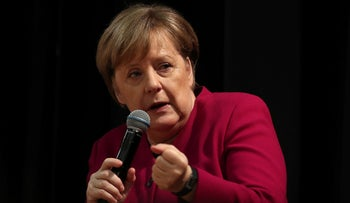 File photo: German Chancellor Angela Merkel talks to students in Athens, Greece, January 11, 2019.