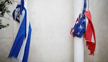 Israeli and U.S. national flags are tied around flag poles at the U.S. Embassy in Tel Aviv, Israel December 6, 2017