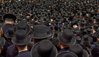 Mourners in the village of Kiryas Joel, N.Y., 45 miles northwest of New York City, around the casket containing the body of the Satmar Rebbe Rabbi Moses Teitelbaum. April 25, 2006