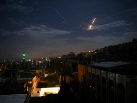 File photo: Syrian air defense batteries responding to Israeli missiles targeting Damascus, January 21, 2019.
