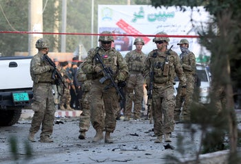 FILE Photo: U.S. soldiers inspect the site of a suicide attack in the heart of Kabul, Afghanistan, August 22, 2015.