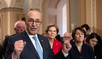 FILE Photo: Chuck Schumer and Elizabeth Warren and Bernie Sanders along with other senators on Capitol Hill in Washington.