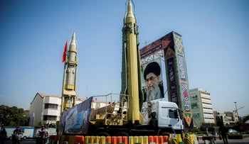 FILE PHOTO: A display featuring missiles and a portrait of Iran's Supreme Leader Ayatollah Ali Khamenei is seen at Baharestan Square in Tehran, September 27, 2017.