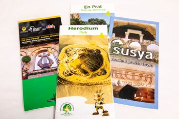 Tourism brochures promoting visits to Israeli-run sites in the West Bank and East Jerusalem.