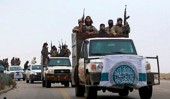 This photo released Dec. 4, 2018 by the al-Qaida-affiliated Ibaa News Agency, shows al-Qaida-linked fighters driving their vehicles during a military drill in northern Syria. It took the al-Qaida-linked militants only few days to capture more than two dozen towns and villages in and around Idlib province, cementing the group's control over an area in northwestern Syria the size of neighboring Lebanon. The push by members of Hayat Tahrir al-Sham, or HTS, is the most serious blow to a September cease-fire for Idlib brokered by Russia and Turkey, and puts tens of thousands of civilians at risk of losing medical support due to a drop in aid from western agencies.