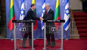 Lithuanian Prime Minister Saulius Skvernelis, left, shaking hands with Prime Minister Benjamin Netanyahu at the Prime Minister's Office in Jerusalem on January 29, 2019.