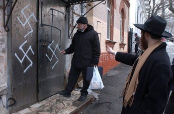 Head of the Jewish community Gennady Klebanov and chief rabbi of Vladivostok Isroel Silberstain at the swastika-smeared door of the synagogue. March 2, 2007