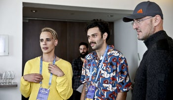 """Actors receiving directions during the filming of the 2019 miniseries """"Douze Points."""""""