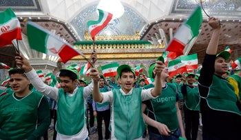 Iranian students wave national flags around the tomb of Ayatollah Ruhollah Khomeini the mark the 40th anniversary of his return from exile, Tehran, Iran, February 1, 2019.