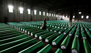File photo: Bosnian Muslim woman searches coffins in Potocari, near Srebrenica on July 9, 2011.