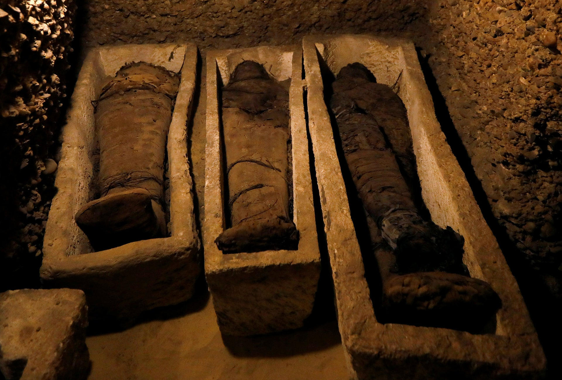 Mummies are seen inside a tomb during the presentation of a new discovery at Tuna el-Gebel archaeological site in Minya Governorate, Egypt, February 2, 2019.