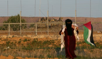 File photo: Palestinian woman walks during a protest at the Israel-Gaza border fence, in the southern Gaza Strip, December 21, 2018.