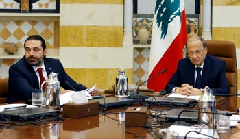 Lebanese President Michel Aoun, right, meets with Prime Minister Saad Hariri, during the first meeting of the Lebanese cabinet at the Presidential Palace in Baabda, east of Beirut, Lebanon, Saturday, Feb. 2, 2019.