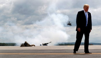 U.S. President Donald Trump observes a demonstration with U.S. Army 10th Mountain Division troops, an attack helicopter and artillery as he visits Fort Drum, New York, U.S., August 13, 2018.