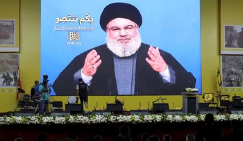 Lebanon's Hezbollah leader Sayyed Hassan Nasrallah gestures as he addresses his supporters via a screen in Beirut, Lebanon August 14, 2018