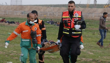 Palestinian paramedics evacuate a protester during a demonstration near the fence along the border with Israel, east of Gaza City, February 1, 2019.