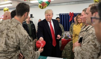President Donald Trump and first lady Melania Trump greet U.S. troops in Al Asad Air Base, Iraq, December 26, 2018.