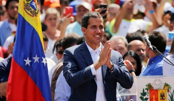 Venezuelan opposition leader Juan Guaido greets supporters at a demonstration in Caracas, Venezuela, Saturday, February 2, 2019.