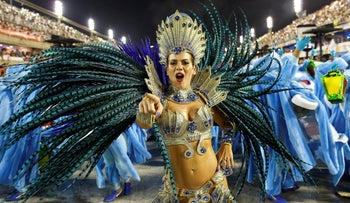 A performer parades during carnival celebrations in Rio de Janeiro, Brazil, February 16, 2015.