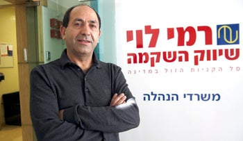Rami Levy, founder and chief executive officer of Rami Levy Chain Stores Hashikma Marketing 2006 Ltd., Israel's largest discount food retailer, poses for a photograph at his company headquarters in Jerusalem, Israel on Sunday, Nov. 23, 2014