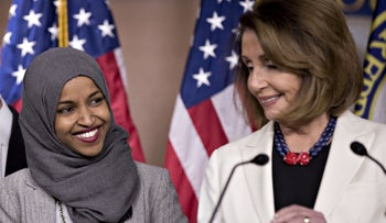 Democratic Rep. Ilhan Omar smiling during a news conference with Nancy Pelosi on Capitol Hill in Washington, November 30, 2018.