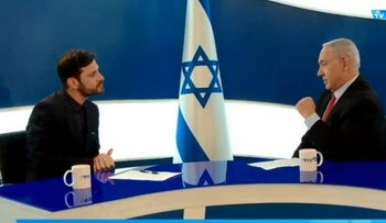 """Israeli actor and former """"Big Brother"""" participant Eliraz Sade interviewing Israeli Prime Minister Benjamin Netanyahu on his new Likud Facebook TV channel, February 2019"""