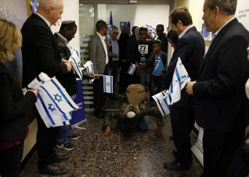 A member of the Falashmura community kisses the ground as he arrives in Israel from Ethiopia along with some 79 other members, Ben-Gurion International Airport, Tel Aviv, February 4, 2019.