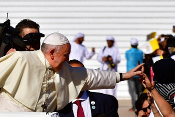 Pope Francis blesses a child as he arrives to lead mass for an estimated 170,000 Catholics at the Zayed Sports City Stadium on February 5, 2019.