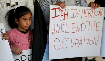 A Palestinian girl protests against Israeli Prime Minister Benjamin Netanyahu's decision not to renew the mandate of the Temporary International Presence in Hebron (TIPH), in Hebron, in the West Bank January 30, 2019
