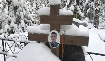 A portrait of Russian private military contractor Alexander Lusnikov, killed in Syria, is seen at his grave at a cemetery in the village of Chyornaya Kholunitsa in Kirov Region, Russia November 28, 2018. Picture taken November 28, 2018