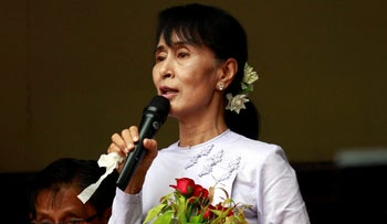 Myanmar pro-democracy leader Aung San Suu Kyi talks to supporters at the headquarters of her National League for Democracy party in Yangon, Myanmar Monday, April 2, 2012.