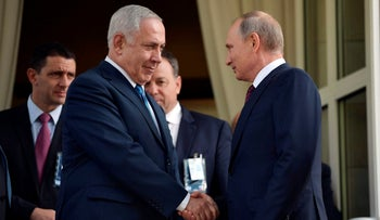 FILE PHOTO: Russian President Vladimir Putin and Prime Minister Benjamin Netanyahu shake hands after their talks in Sochi, Russia, August 23, 2017.