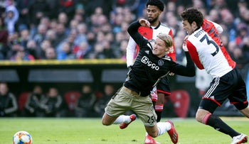Feyenoord's Eric Botteghin fights for the ball with Ajax's Kasper Dolberg during match between Feyenoord Rotterdam and Ajax Amsterdam in Rotterdam, January 27, 2019.