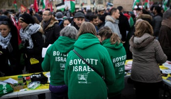 """FILE PHOTO: Demonstrators wear shirts reading """"Boycott Israel"""" during a protest against Trump's decision to recognize Jerusalem as Israel's capital, in Paris, France, on Saturday, December 9, 2017."""