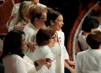 Rep. Alexandria Ocasio-Cortez (D-NY) joins fellow Democratic members of Congress before U.S. President Donald Trump delivers his State of the Union address to a joint session of Congress on Capitol Hill in Washington, U.S., February 5, 2019. REUTERS/Jim Young - HP1EF2605US1E     TPX IMAGES OF THE DAY